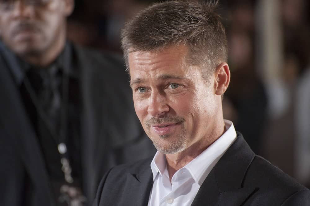 Brad Pitt's military-inspired fade rose to fame when it appeared on screen after the release of the 2014 American War film named Fury. While the film grossed millions of dollars at the box office, it also inspired millions of men and boys across numerous countries to shave off half their head in Brad Pitt-style. Although the actor himself gave up the look shortly after the filming was complete, this impressive haircut is still one of the most sought-after styles given how tough and sturdy it makes one appear.