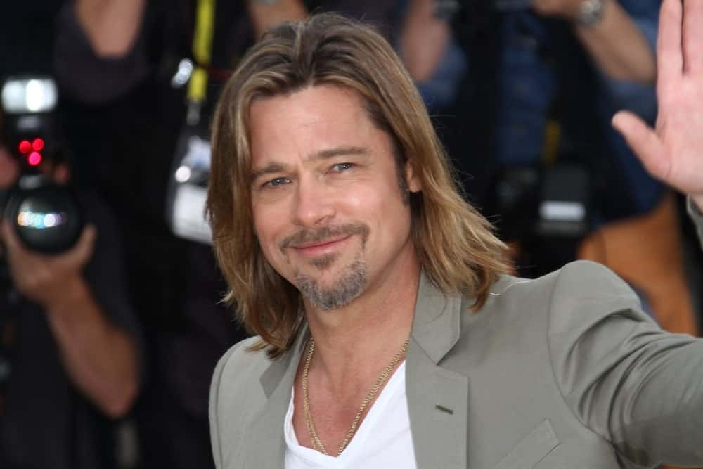 Brad Pitt never ceases to surprise us with his amazing hairstyles, and he does it yet again with his incredibly long hair that has been painted beautiful shade of light blonde. With darker roots and light colored hair all over, it greatly complements his face and beard and suits him really well, too.
