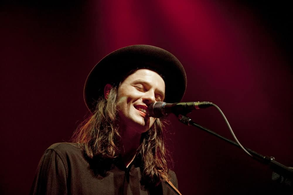 James Bay looks like an absolute rock star here with his uber long wavy hair that has been a colored a beautiful shade of brown. He has accentuated the whole long hair look with a cowboy like hat that makes him look like he has come right out of a fashion magazine.
