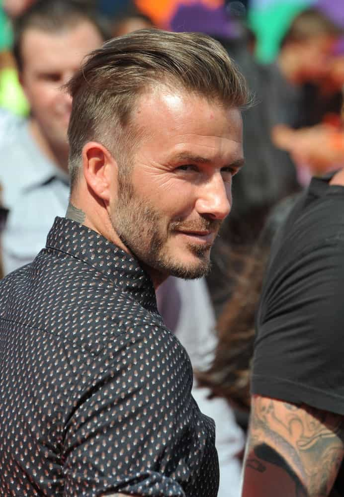 Although this style comes closer to an undercut than a fade haircut, it still deserves a special mention in our list nonetheless because it was not just adored by the skilled footballer/ fashion icon himself (he sported it for years after all) but also loved by his fans worldwide. Beckham styled the longer strands at the top in a slicked-back manner rather than letting them drape over the sides for a more refined and luxe look.