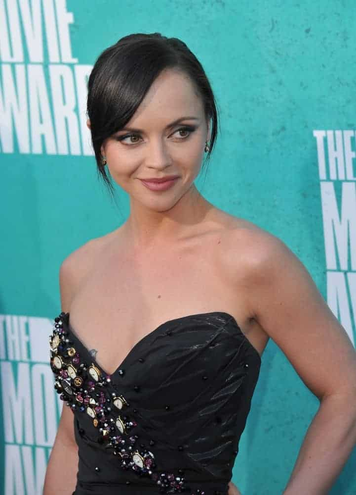 Christina Ricci was at the 2012 MTV Movie Awards at Universal Studios, Hollywood on June 4, 2012, in Los Angeles, CA. She wore a sexy strapless black dress that went well with her raven bun hairstyle that has loose bangs.