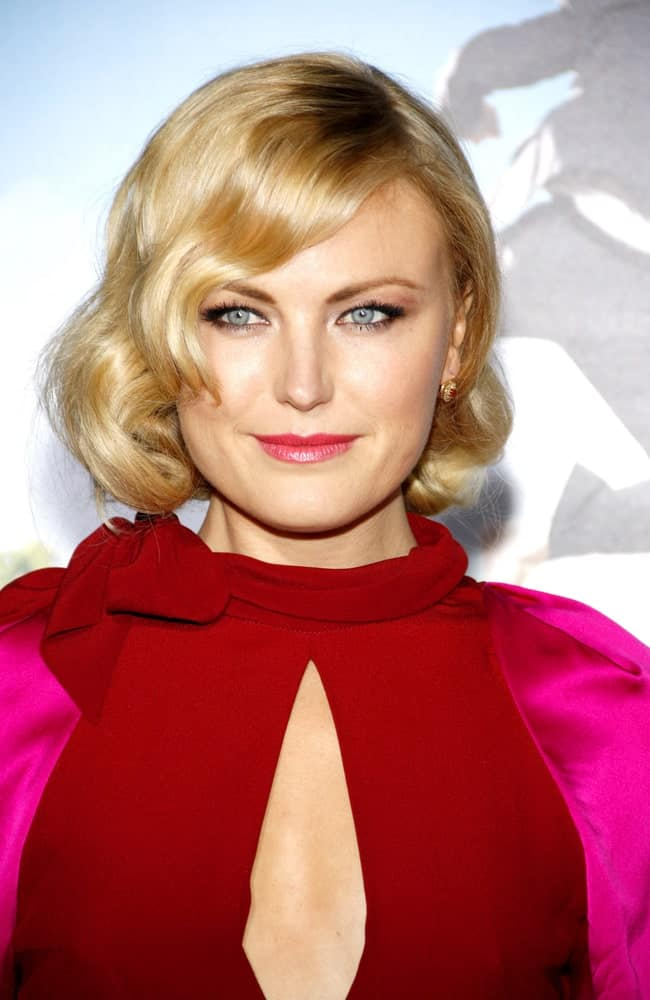 "Malin Akerman had a retro look with her colorful dress and curly bob with side-swept bangs at the Los Angeles Premiere of ""Wanderlust"" held at the Mann Village Theater last February 16, 2012."