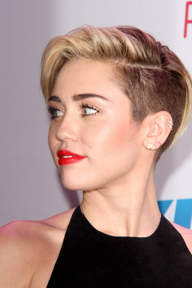 Miley Cyrus paired her black dress with sexy bold red lips and a side-swept pixie hairstyle with an undercut finish at the KIIS FM Jingle Ball 2013 at Staples Center on December 6, 2013 in Los Angeles, CA.