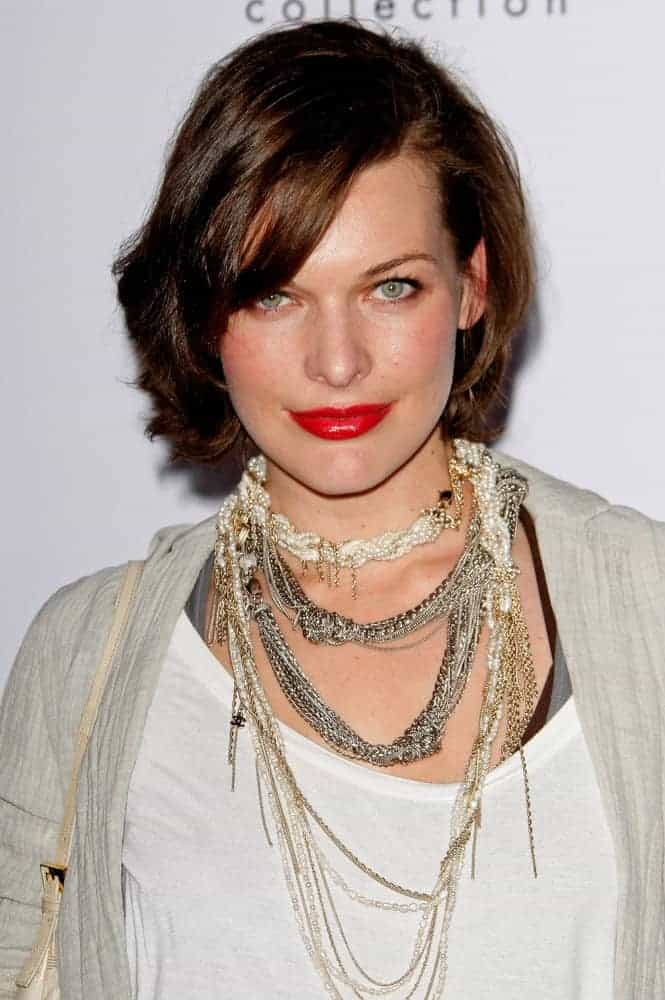 Milla Jovovich was at the Calvin Klein Collection & Los Angeles Nomadic Division 1st Annual Celebration on January 28, 2010, in Los Angeles, California. She was seen wearing a fashionable casual outfit with her chin-length brunette hairstyle with side-swept bangs.