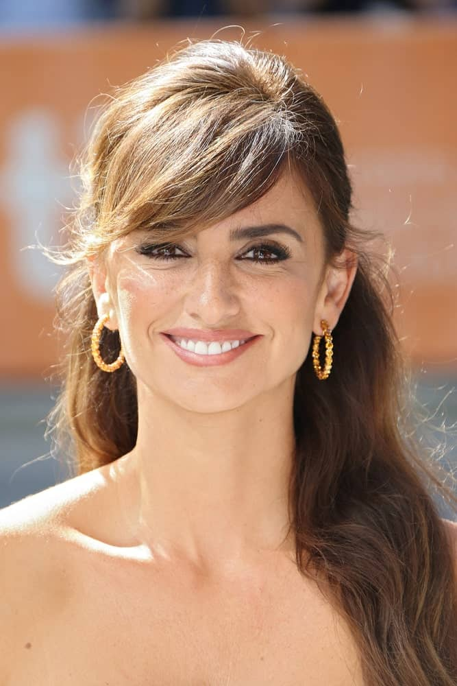 Penelope Cruz exhibits a charming aura in this half upstyle with side-swept bangs worn at the 'Ma Ma' premiere during the 2015 Toronto International Film Festival on September 15, 2015.