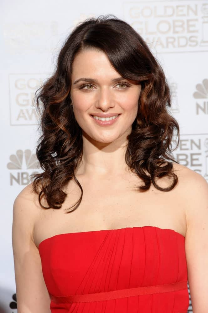 Rachel Weisz exhibits a ravishing look with a red dress paired with side-swept curls at the 64th Annual Golden Globe Awards held on January 15, 2007.