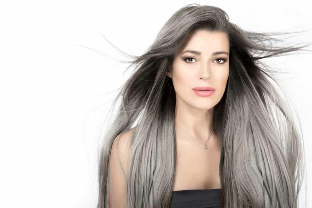 Attractive woman with long silver hair.