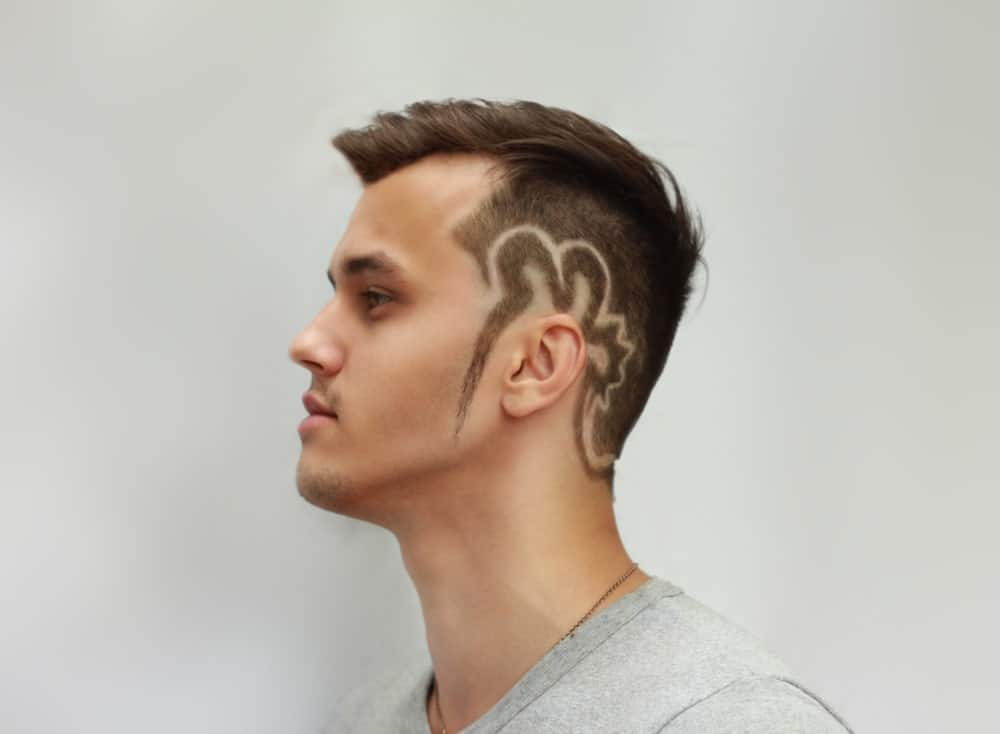 This is probably the boldest of all undercut hairstyles since this one includes a hair tattoo that starts from the sides and extends all the way down towards the nape of the neck. It is a mixture of the short undercut and the side-swept undercut, just with the addition of a funky and unique hair tattoo.