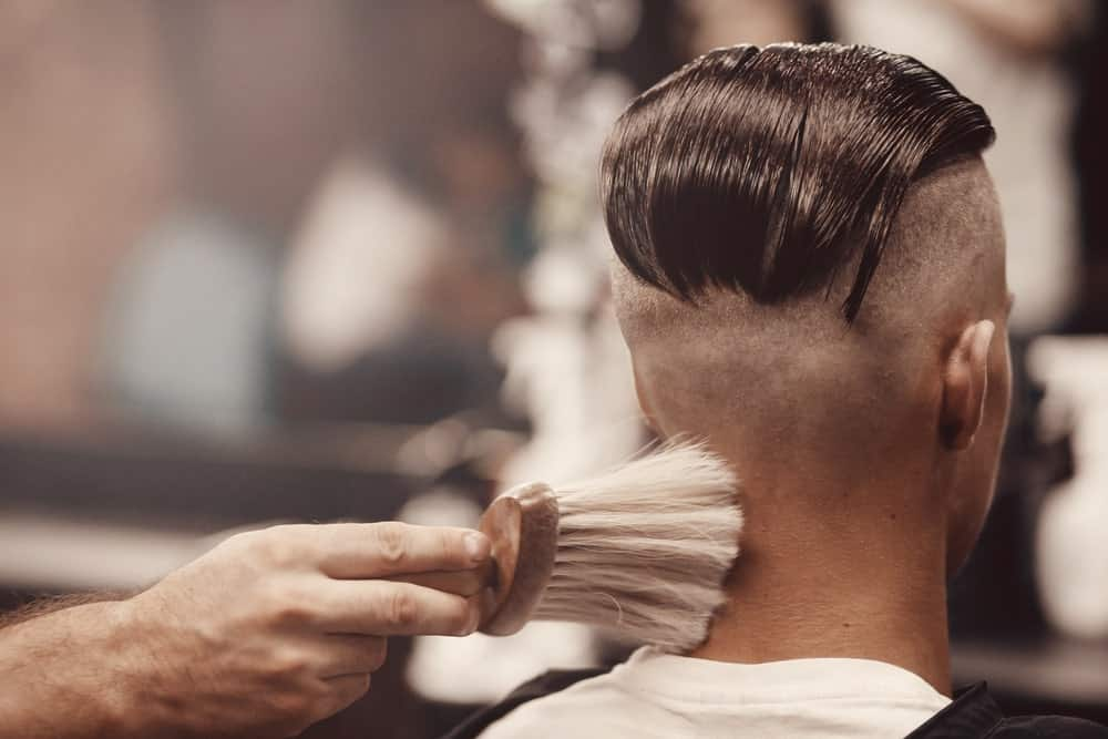 All those with a weak heart should probably stay away from this undercut hairstyle because it is nothing short of crazy, risky and simply exaggerated! One of its key features is the long-slick of hair that goes back all the way down to the middle of the head. The sides and the bottom back are completely shaved off and the only hair you will see is the thick lock from the front in the middle that is gelled all the way towards the back.