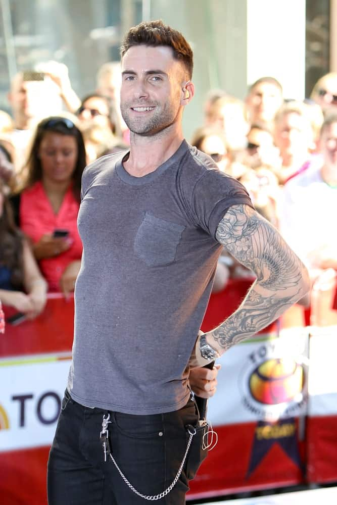 Adam Levine has to be one of the most stylish and fashionable men in terms of hairstyles and clothing, and he is proving that here with this classic short undercut that perfectly complements his face cut. He has tweaked the undercut style a bit by completely shaving the sides and leaving short hair at the top. With an almost clean-shaved beard, he looks absolutely dapper in this hairstyle. His prominent jawline also adds to the look, taking it to a whole new level.