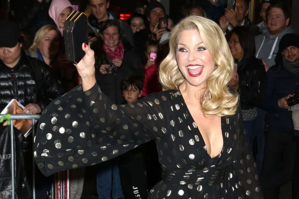 Christie Brinkley waving