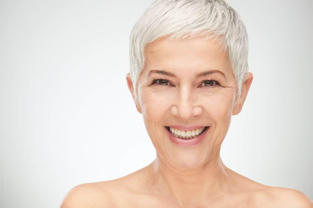 Senior woman with short white hair.