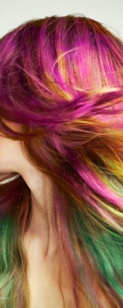 A young, beautiful girl with colored hair