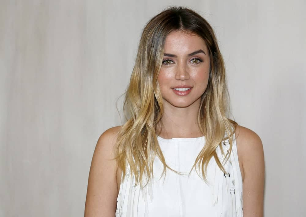 Ana de Armas posing in a white formal dress