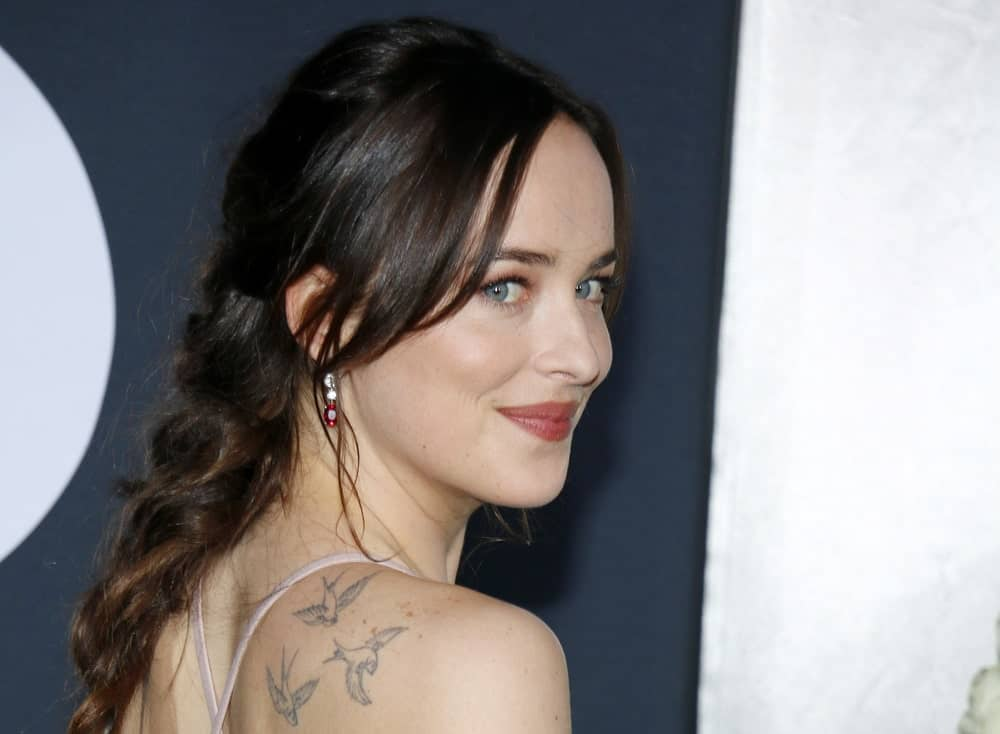 A side pose of Dakota Johnson