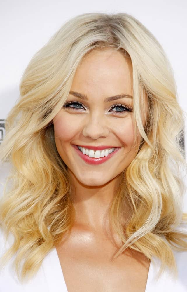 Laura Vandervoort smiling in a white dress