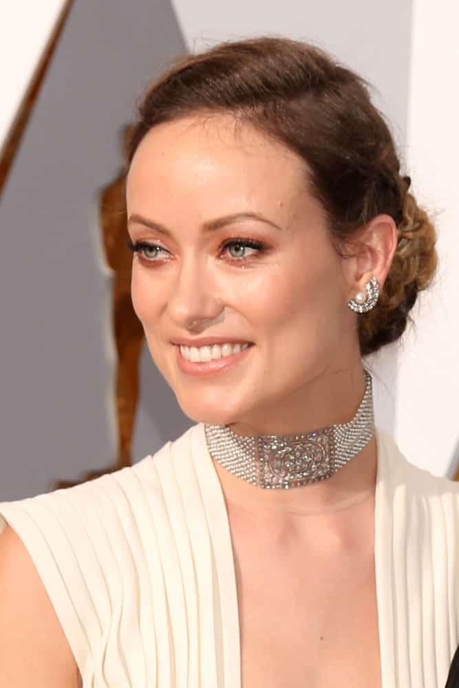 Olivia Wilde smiling at an awards function