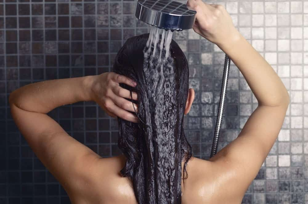 Woman rinsing out conditioner