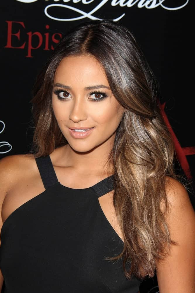 Shay Mitchell wearing a balck dress