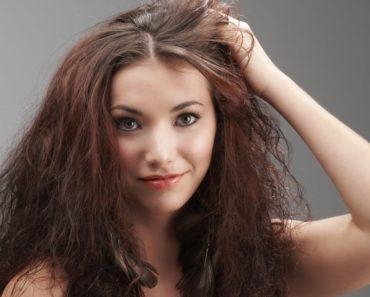 Women grabbing her frizzy hair