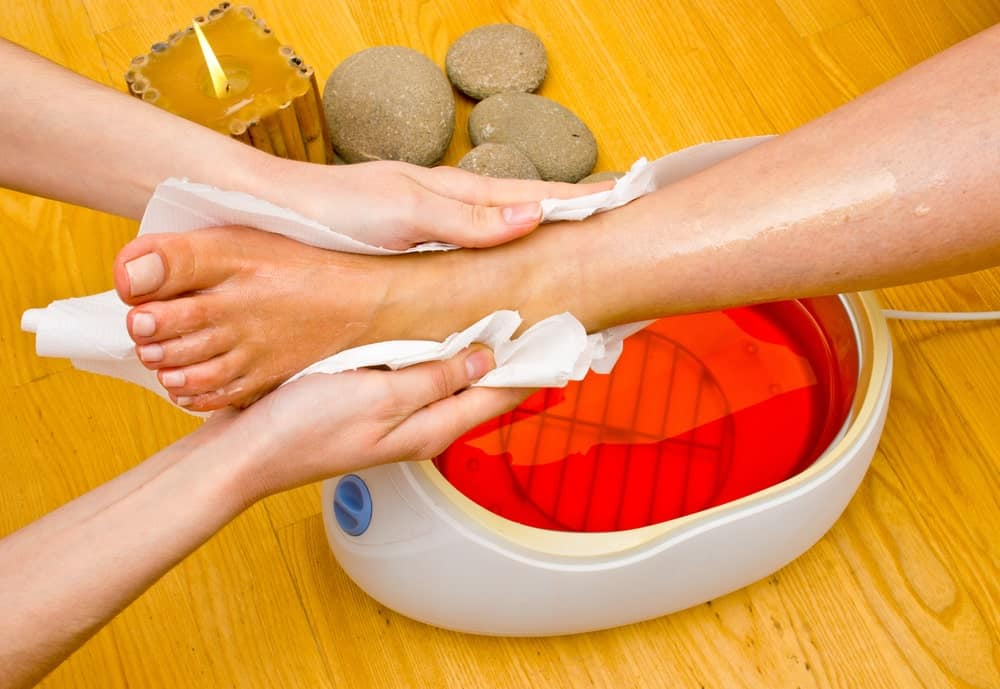 Paraffin applied to a woman's foot