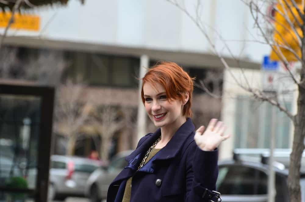 Comic and Entertainment Expo Parade Actress Felicia Day from Supernatural rides in parade proceeding Calgary Comic Expo.