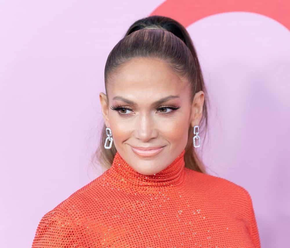 Jennifer Lopez wearing dress by Ralph Lauren attends 2019 CFDA Fashion Awards at Brooklyn Museum.