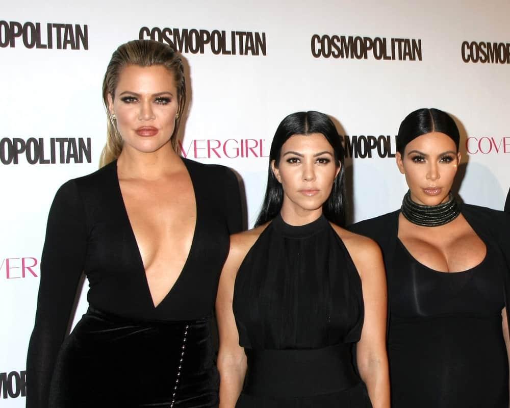 Khloe Karsahian, Kourtney Kardashian, Kim Kardashian West at the Cosmopolitan Magazine's 50th Anniversary Party at the Ysabel on October 12, 2015 in Los Angeles, CA.