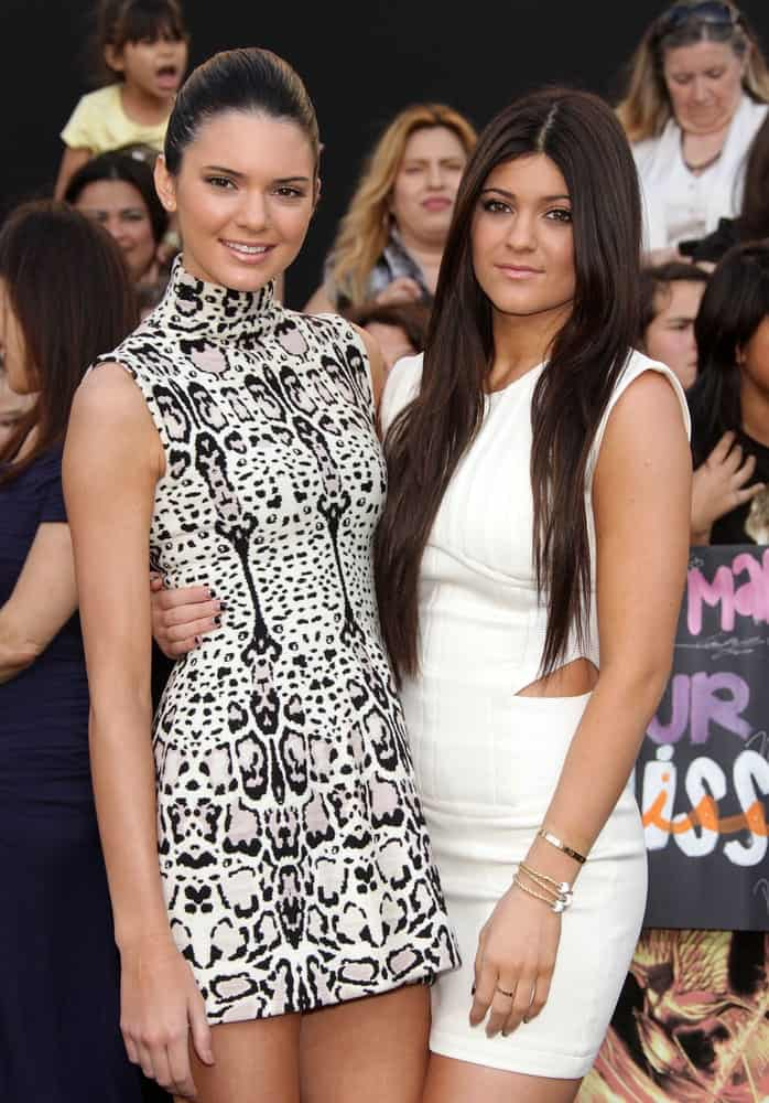 KENDALL & KYLIE JENNER arrives for the