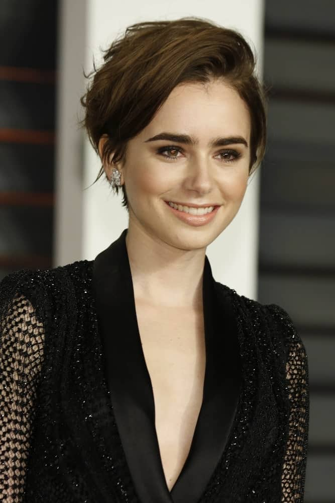 Lily Collins at the Vanity Fair Oscar Party 2015 at the Wallis Annenberg Center for the Performing Arts on February 22, 2015 in Beverly Hills, CA.
