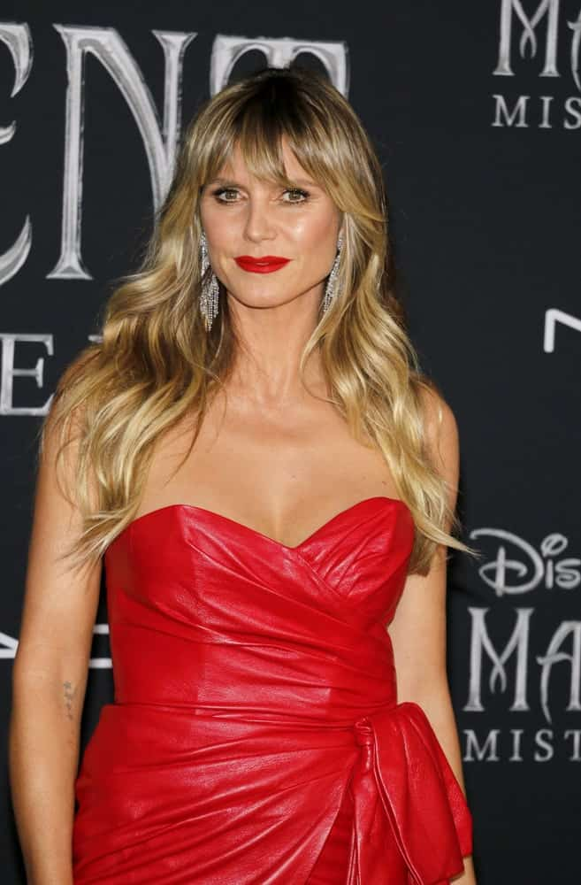 Heidi Klum looked stunning in a red dress along with a soft curl and eye-skimming bangs. This was at the World premiere of Disney's 'Maleficent: Mistress Of Evil' on September 30, 2019.