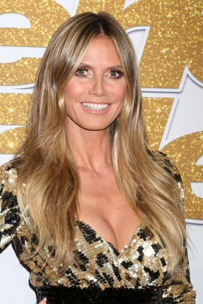 Another side bangs that perfectly go along with soft wavy hair. The TV personality arrives for the