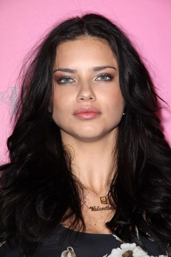 Adriana Lima had a long dark tousled and loose layers at the Victoria's Secret release of the 2011 What Is Sexy? list and the kickoff to the bombshell summer tour in Los Angeles last May 11, 2011.
