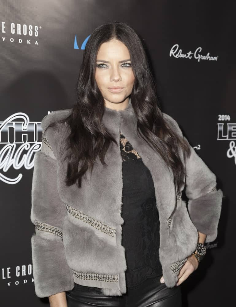 FEBRUARY 01, 2014 was when Adriana Lima attended the 11th Annual 'Leather & Laces' Party at The Liberty Theatre wearing an edgy ensemble to match her fierce black wavy hairstyle and smoky eyes.