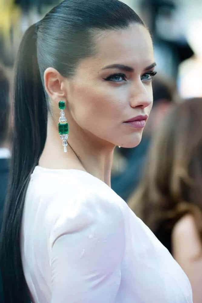The Brazillian model showcased her sleek and tight ponytail during the premiere of 'Julieta' at the 69th Festival de Cannes, May 17, 2016. This is complemented by her white outfit and emerald earrings.