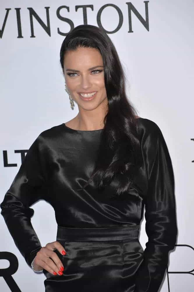 The model went with a style that is simple yet elegant that pairs a black satin dress with her long black wavy hair swept to the side during the amfAR Cinema Against AIDS Gala 2016.