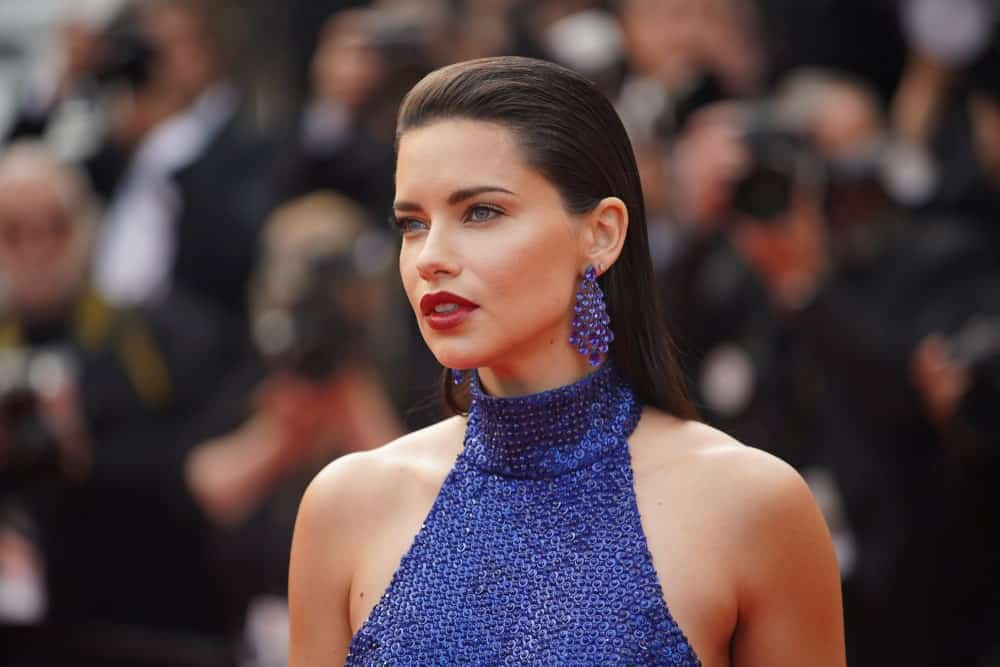 "Adriana Lima paired her blue gorgeous earrings to her blue sequined dress last May 22, 2019 at the gala premiere for ""Oh Mercy!"" in the Festival de Cannes. Her long straight black hair was brushed back for a sophisticated look."