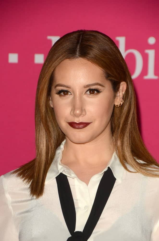 Tisdale attended the T-Mobile Un-carrier X Launch Celebration at the Shrine Auditorium on November 10, 2015, with a simple classic look showcasing her sleek center-parted blonde hair.Tisdale attended the T-Mobile Un-carrier X Launch Celebration at the Shrine Auditorium on November 10, 2015, with a simple classic look showcasing her sleek center-parted blonde hair.