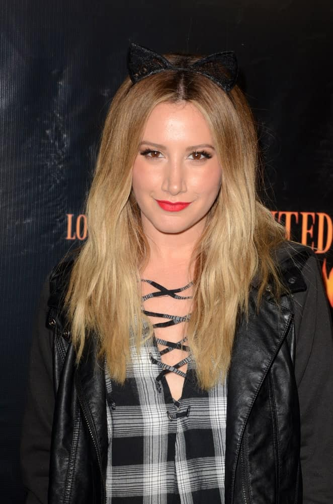 Ashley Tisdale exhibited an outrageous look during the Haunted Hayride 8th Annual VIP Black Carpet Event at the Griffith Park on October 9, 2016, with her tousled blonde hair complemented by cat ears headband.