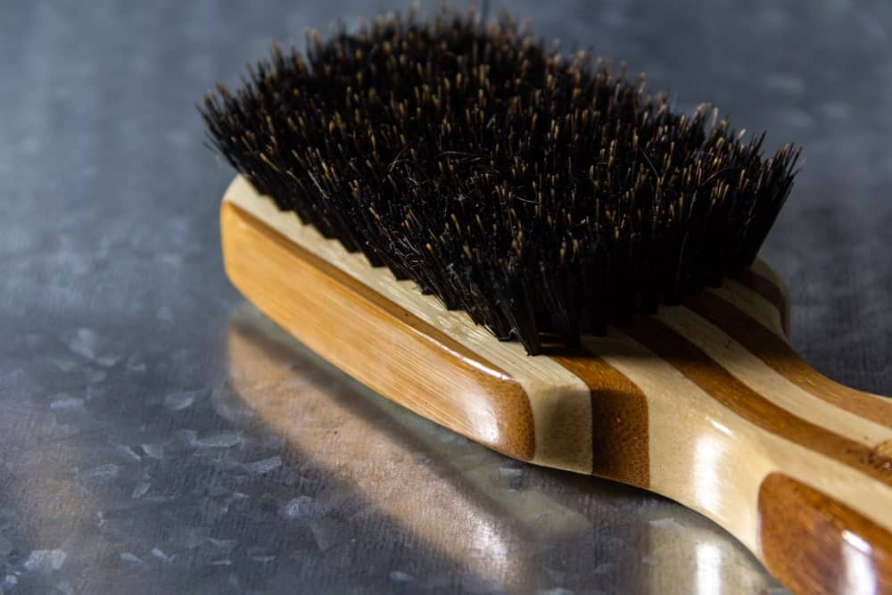 Hair brush with boar hair bristles.