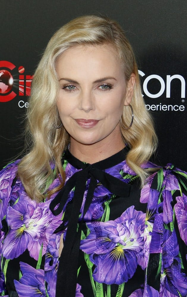 Charlize Theron looked charming in a floral dress paired with a permed hairstyle that's side-parted. This look was worn during the Focus Features Luncheon And Studio Program Celebrating 15 Years held on March 29, 2017.
