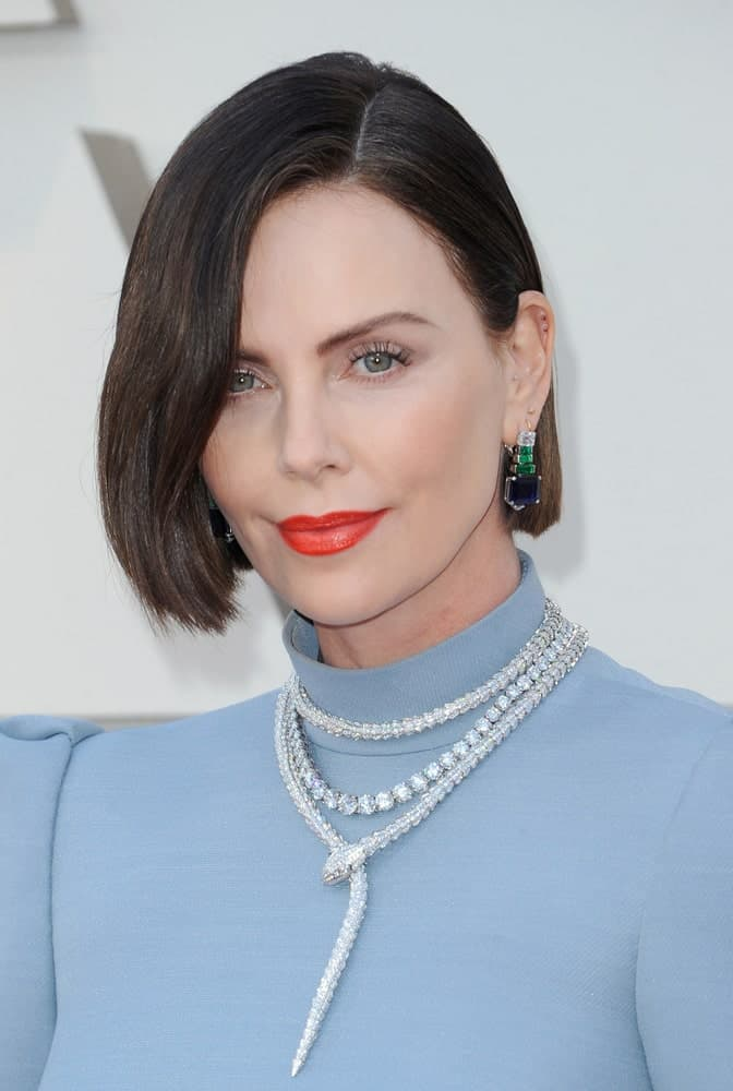 Charlize Theron looked ravishing on a side-parted bob and light blue turtleneck dress that's paired with a layered necklace and gorgeous earrings. This was worn during the 91st Annual Academy Awards on February 24, 2019.