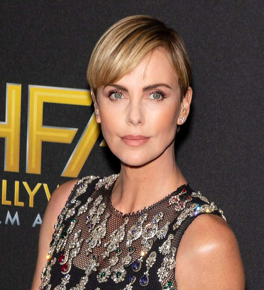 Charlize Theron sported her blonde pixie with side-swept bangs at the 3rd Annual Hollywood Film Awards last November 3, 2019. She completed the look with a black netted top inlaid with gem embellishments.
