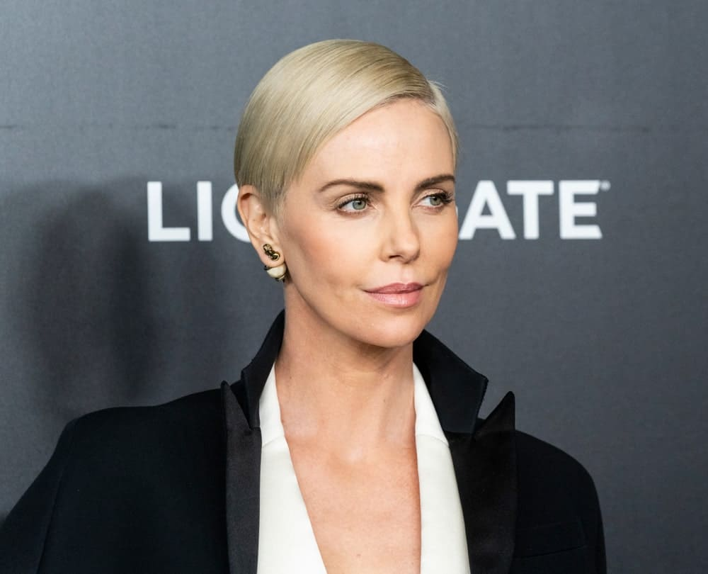 Charlize Theron flawlessly flaunts her sleek pixie blonde hair on a side-swept hairstyle during the Bombshell special screening last December 16, 2019. She paired it with a dress by Dior along with beautiful double-sided stud earrings.