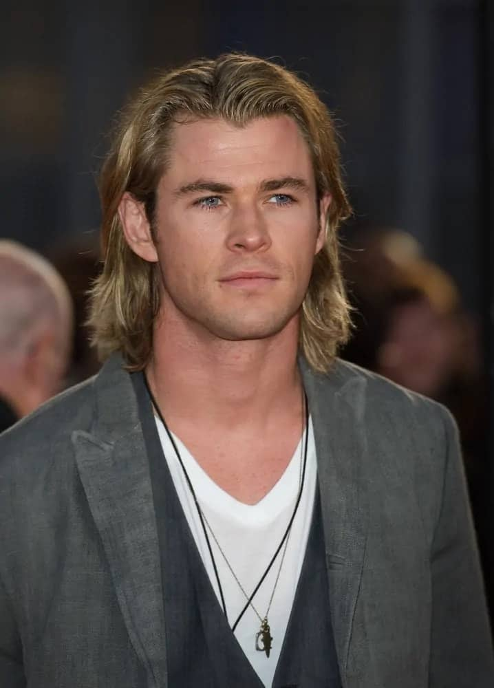 The actor had long dirty blond locks and a gray suit when he arrived at The Hunger Games Premiere in London last 2012.