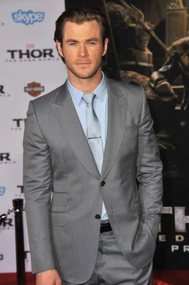 """Chris Hemsworth tamed his long dark brown hair with a slicked-back pompadour hairstyle and five o'clock shadow at the premiere of his 2013 movie, """"Thor: The Dark World""""."""