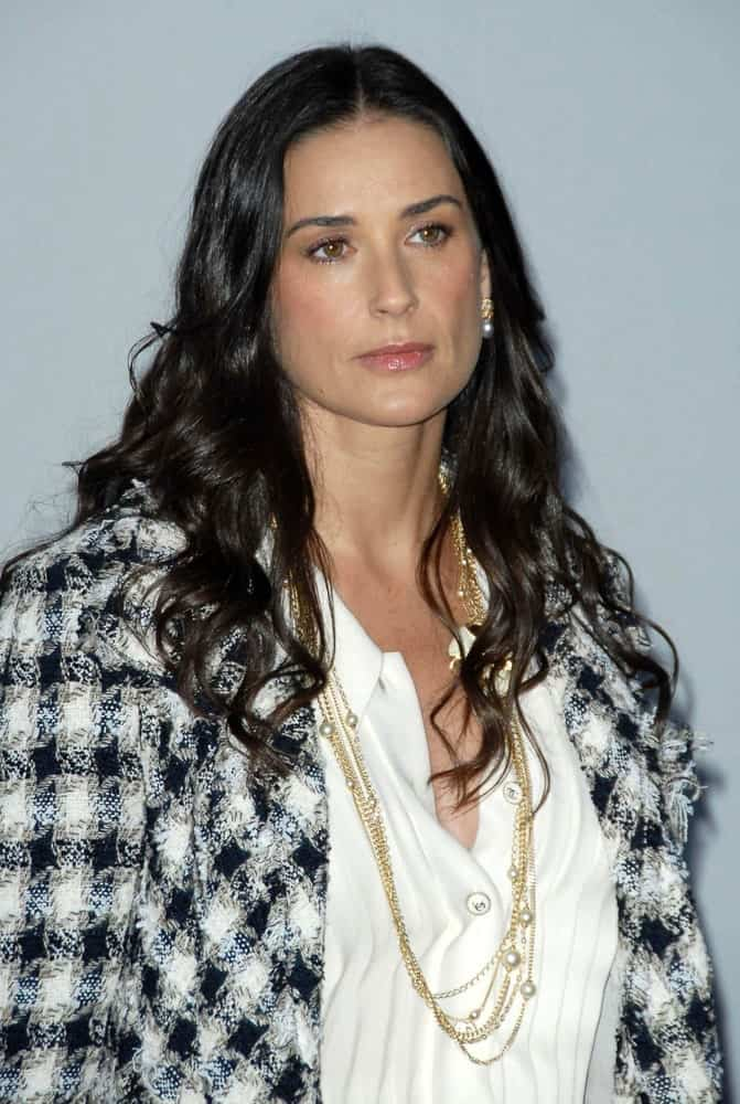 Demi Moore sported a center-parted permed hair with defined curls during the 2007/2008 Chanel Cruise Show Presented by Karl Lagerfeld last May 18, 2007. She complemented it with a classy chic outfit showcasing a white button-down topped with a plaid blazer and layered necklace.