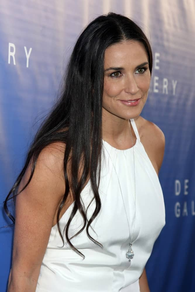 Demi Moore rocks in a white halter dress that's paired with a long necklace along with her black tousled hair partially permed with subtle waves. This look was worn during the De Re Gallery Opening last May 15, 2014.