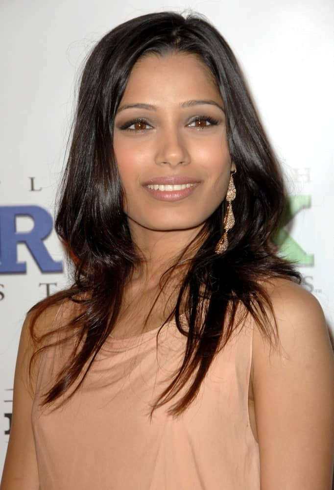 Freida Pinto had a slight brownish tinge of highlights on her long raven hair that was tousled and layered at the 2009 PGA Producers Guild Awards in Los Angeles last January 24, 2009.