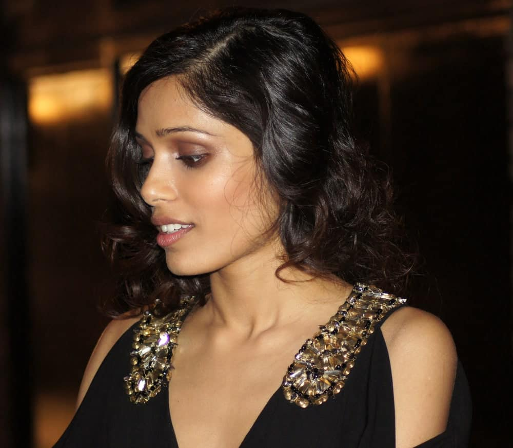 Freida Pinto's dark hair was styled into this curly and loose sexy look at the 'Miral' Premiere last October 18, 2010 in Leicester Square London, England.
